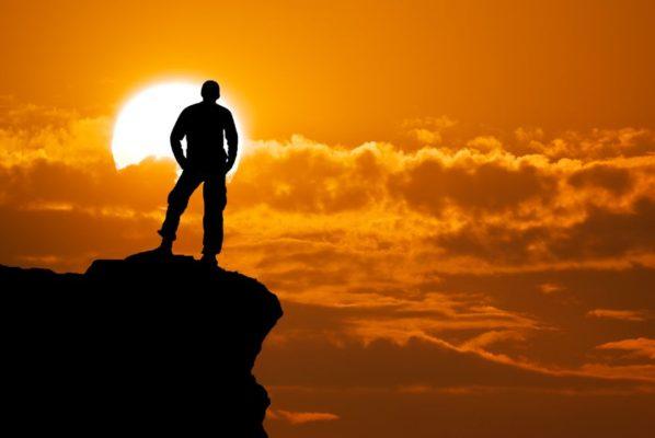 14747492 - man on top of mountain conceptual design